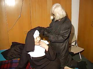 An old nun is about to experience something that she never though it's possible. This blonde unties her hands and gives the old bitch some whipping. She then rolls her over whips her some more and begins to undress. This is a classic and things are just about to get a lot more interesting, stay with us and watch