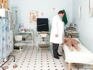 Naked Mature lady with big tits visits the doctor for her pussy examination. She is ordered to lay on the patient's bed doctor examines her abdomen and then wears his gloves and tells her to spread her legs so that her cunt can be tested. Doctor examines it and then checks her ass and ask her if she had anal sex ever she..