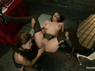 Brunette milf is gagged with a scarf and put on a table by mature domina Francesca Le. She makes her way into her asshole while rubbing her sweet shaved pussy. The black haired woman gets her asshole fisted deeper as she gets more horny. She moans with pain and pleasure.