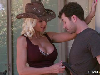 Puma Swede is a gardener, selling her services door-to-door. She offers other 'services' as well, but gives the first one free. She gets her huge tits squeezed and licked before going in the house. James gets smothered in them, sucking them as she wraps her legs around him.