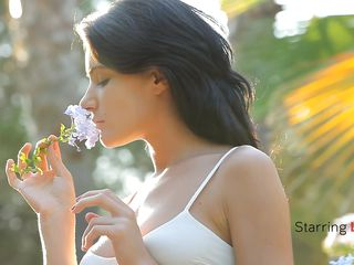 Luiza smells the flowers and acts gentle, just like a lady should. She loves nature and relaxes in the middle of it with her boy. Luiza approaches, sits on top of the guy and begins kissing him tender. Look at her butt, so tight and firm, just like her tits are. She forgets about the flowers and starts sucking cock.