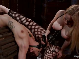 Blonde milf Aiden doesn't tolerates sluts that do not obey so this one that has been tied on that special device is about to learn something about submission which goes perfectly with a good old anal fuck. She has a strap on simply for the pleasure of her mistress and after the blonde has enough she starts penetrating her anus