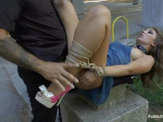 Cristal Cherry is tied up and naked in public when suddenly a guy came and starts licking her shaved pussy and then starts to fuck her while two other guys are watching and thinking if they are next. Do you think that the guy will cum on Cherry's pretty face or on her nice boobs?
