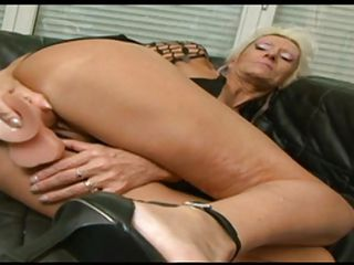 Horny Gilf Claudia masturbates by inserting a big dildo in her old but still hot vagina. This old blonde slut loves a good fuck and when this guy here sees how she fucks herself he gives her a helping hand, fingering her ass and then inserting the sex toy in her anus. Because she enjoyed his help, she gets down on her knees..