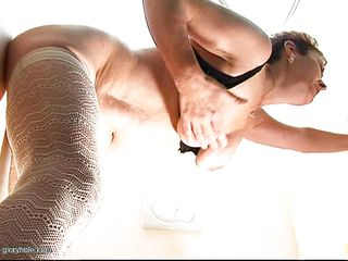 Katarina is a horny mature and she loves big black cocks and the hot white jizz that comes out of them. She is taking that dick in her cunt from behind and then kneels and sucks it until a big load of sperm satisfies her. Her face looks nice with all that semen on it, don't you think so?