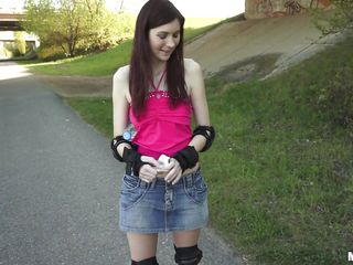 This sexy redhead on roller skates will do anything for money. She reveal her small tits and then takes her panties of in the middle of the street and wrapping her juicy lips around a hard cock. Will she take that cock deep into her tight pussy to earn her money or she will get a mouth full of cum?