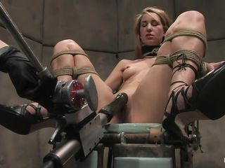 Calico gets her pussy fucked hard by that fucking machine, see how that dildo enters her vagina deep, fucking this horny slut until she screams with pleasure? The guy ties her pretty mouth and then another guy that is a technician operates the machine, giving this blonde a hell of a fuck. Do you enjoy seeing her hard nipples..